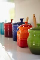 Colourful ceramic pots with lids