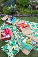 Picnic in garden with individually packed wooden crates used as picnic hampers