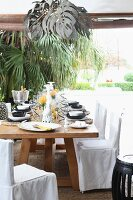 A table set for a celebration on a terrace