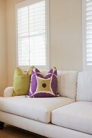Cushions on couch against window in the living room; Azusa; California; USA