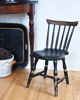 Vintage kitchen chair made from dark wood with turned legs