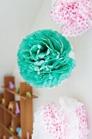 Paper pompoms on wall of child's room