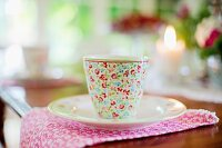 Floral breakfast cup and saucer on linen napkin