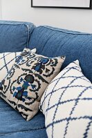 Scatter cushions on sofa with denim upholstery