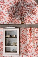 Vintage, glass-fronted cabinet on half-timbered wall with wallpapered panels