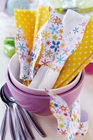 Napkin rings hand-crafted from colourful, floral paper
