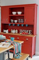 Red dresser in kitchen