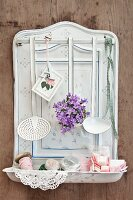 Various utensils, ladles and campanula on white enamel spoon rack