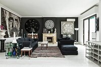 Black sofa set and delicate coffee table on rug in lounge area with black accent walls and large portrait n one wall