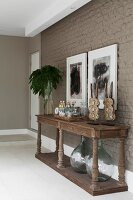 Rustic console table with turned legs against wall painted mud brown in modern foyer