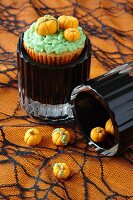 Halloween cupcakes decorated with marzipan pumpkins