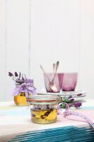 Preserving jar of lavender honey decorated as a gift