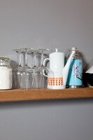 Wine glasses, 70s coffee pot and retro thermos flask on narrow kitchen shelf