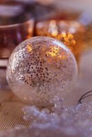 Transparent Christmas tree bauble decorating table (close-up)