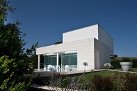 Contemporary house with pool and summery garden