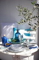 Table set with blue and white crockery on terrace