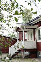 Traditional Swedish house with steps leading to front porch