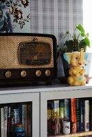 Retro radio and toy elephant on top of cabinet