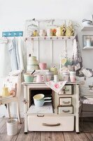 Various item of pastel kitchenware on old cooker