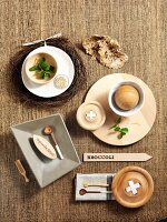 Arrangement of items made of natural materials such as wood, sisal and linen on table