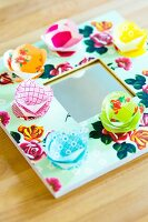 Mirror with frame decorated with floral paper and hand-crafted paper flowers