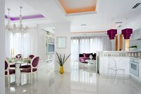 Glossy white floor in elegant, open-plan living space with purple and gold accents