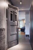 Vintage door in modern hallway