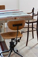 Retro swivel chair and child's high chair at vintage table