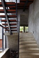 Staircase with concrete treads in architect-designed house