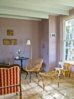 Wicker stool and chair in country-house interior painted lilac