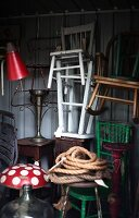 Stacked chairs and vintage occasional furniture in storeroom