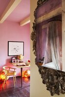 Canopied bed reflected in Baroque mirror and modern table and chair in pink, teenager's bedroom