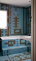 Bathroom tiled in imaginative patterns of blue and brown mosaic tiles