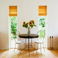 Sunflowers on circular table against wall