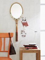 An old tennis racquet used as a mirror frame