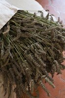 Dried lavender in linen bag on pouffe