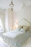 Bed with tall headboard in pale, Scandinavian bedroom in elegant, country-house style