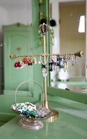 Earrings on brass jewellery stand