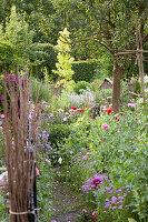 Bundled twigs in flowering garden