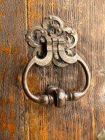 Vintage handle on rustic wooden door