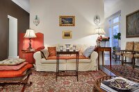 Traditional living area with Oriental rugs and antique furniture of various styles