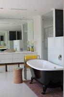 Freestanding vintage bath tub in a modern bathroom
