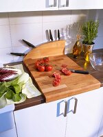 Chopping board with additional knife block in kitchen