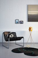 DIY home accessories - chair made from doormat and galvanised pipes, plant stand made from wooden canes and rope rug