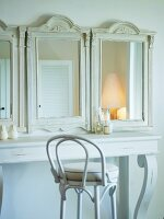 Dressing table made from white-painted table and antique wood-framed mirrors