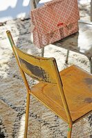 Vintage metal chairs painted different colours on Berber-style rug