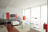 Designer interior with plexiglas furniture and orange accents