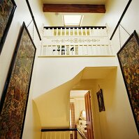 Narrow staircase with gallery and skylight