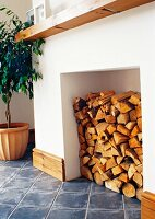 Stack of firewood in disused open fireplace