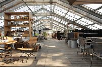 Converted greenhouse with dining area in foreground